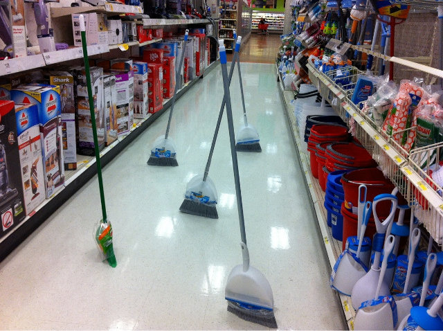 brooms in a store
